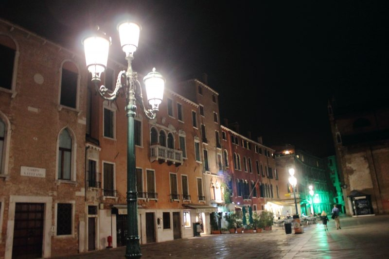 A night photo of Campo Santo Stefano square at night