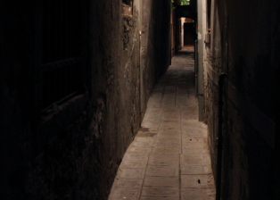 Dark alleys give the gritty, urban, shadowy feel. Darkness in Venice allows you to travel back in time.