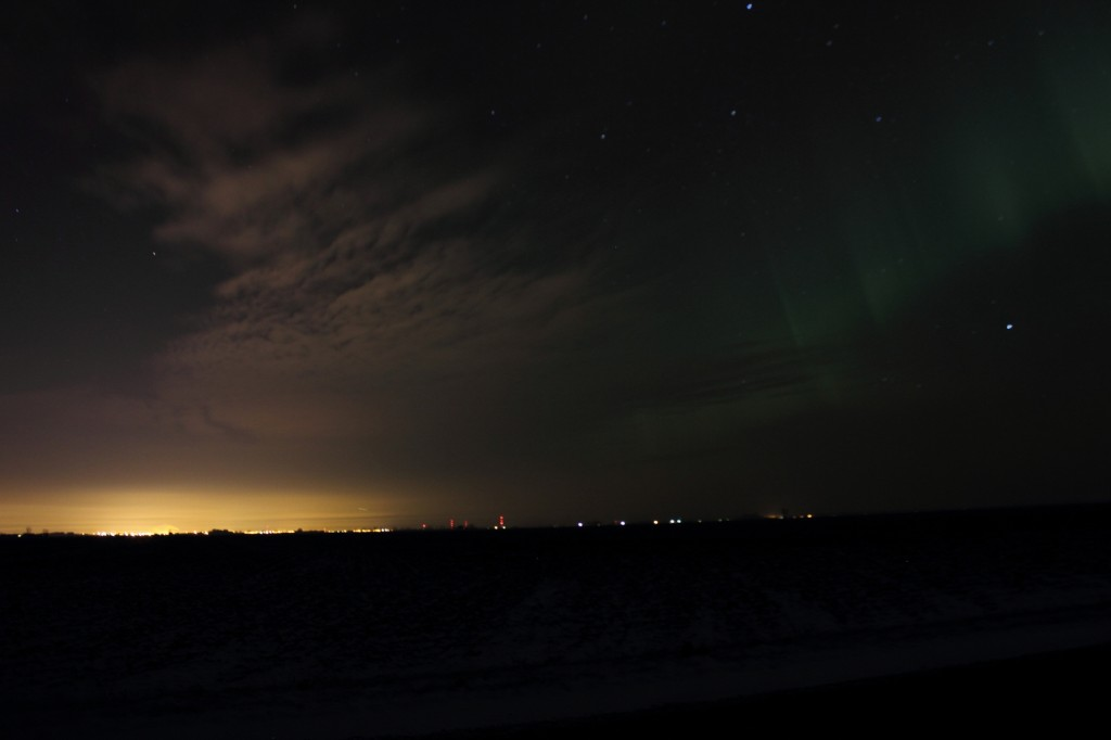 Aurora over city