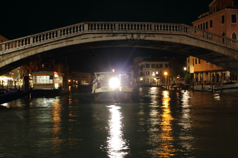 Night photo of the  Night Water Bus  in Venice